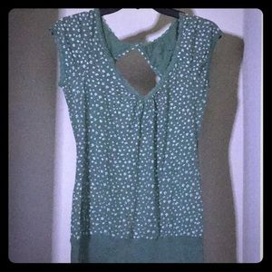 Green blouse with small white flowers printed